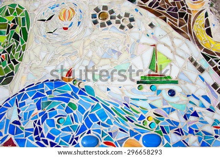 mosaic on the wall made of broken colored tiles - stock photo
