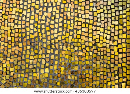 Mosaic tile background. Mosaic decoration in golden colors. Abstract texture of byzantine smalt in old tradition. - stock photo