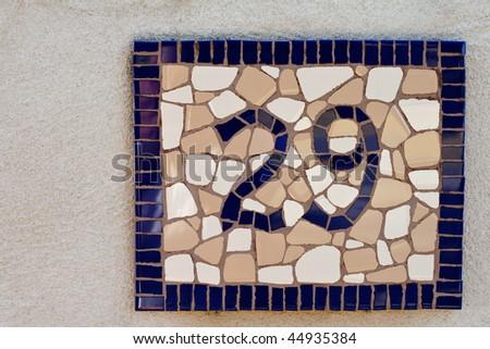 mosaic tiled number twenty nine sign for home - stock photo