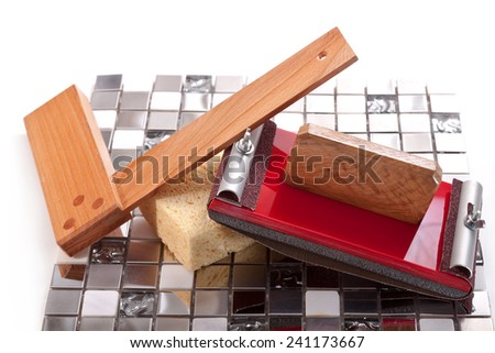 Mosaic tiles consisting of stone, glass and aluminum, square, sponge, a device for grinding walls - stock photo