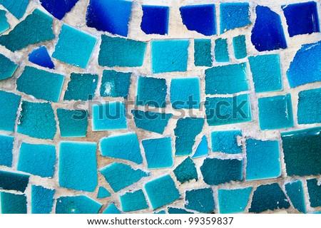 Mosaic wall decorative ornament from broken ceramic tiles - stock photo