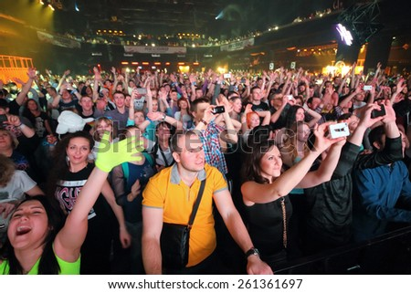 MOSCOW - APR 05, 2014: A crowd of happy young people at the Trancemission in Stadium Live - stock photo