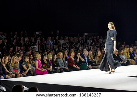 MOSCOW - APR 4: Model walk at podium in Gostiny Dvor during Valentin Yudashkin show at opening of 27th Volvo Fashion Week, April 4, 2012, Moscow, Russia. - stock photo