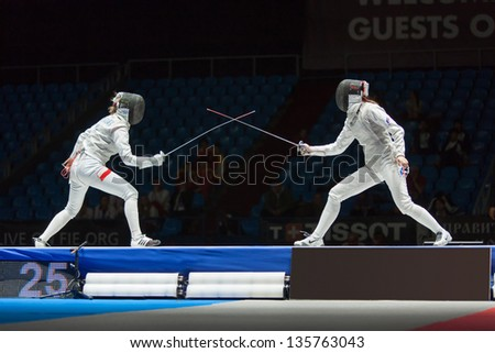 MOSCOW - APR 6: Start of fight on championship of world in fencing among juniors and cadets, in Sports Olympic complex, on April 6, 2012 in Moscow, Russia - stock photo