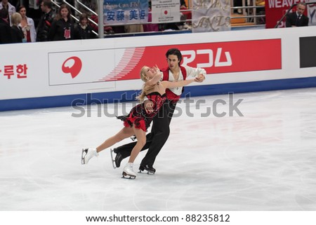 "MOSCOW - APRIL 30: Andrew Poje and Kaitlyn Weaver compete in the pair ice dance at the 2011 World championship figure skating event at the Palace of sports ""Megasport"" on April 30, 2011 in Moscow, Russia. - stock photo"