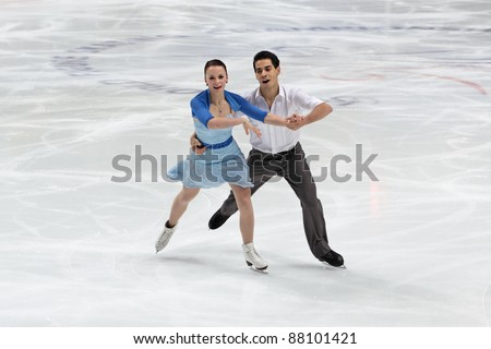 "MOSCOW - APRIL 30: Anna JoAnn Cappellini and Luca Lanotte compete in the pair ice dance at the 2011 World championship figure skating event at the Palace of sports ""Megasport"" on April 30, 2011 in Moscow, Russia. - stock photo"