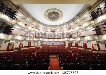 MOSCOW - APRIL 23: Auditorium of Large stage in Vakhtangov Theatre on April 23, 2012 in Moscow, Russia. Light and sound systems of Vakhtangov Theatre are one of best in Russia. - stock photo