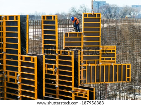 MOSCOW - APRIL 17: Construction site worker on april 17, 2014 in Moscow, Russia. Urban construction is at a faster pace in Russia. - stock photo