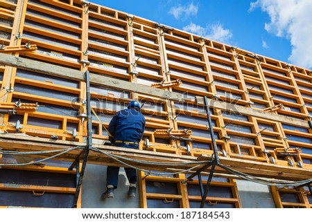 MOSCOW - APRIL 10: Construction site worker on formwork on april 10, 2014 in Moscow, Russia. Urban construction is at a faster pace in Russia. - stock photo