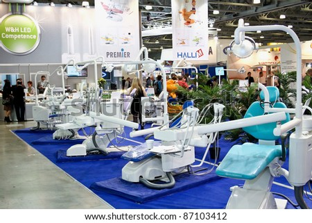 MOSCOW - APRIL 27: Group dentist chair and tools at the international exhibition of the dental professionals and industry on April 27, 2011 in Moscow - stock photo