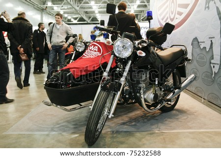 MOSCOW - APRIL 1: Motorcycle Jawa 350 with sidecar at the Moscow specialized Exhibition  of motor cycling industry in Russia on April 1, 2011 in Moscow, Russia - stock photo
