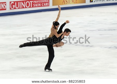 "MOSCOW - APRIL 30: Tessa Virtue and Scott Moir Soloviev compete in the pair ice dance at the 2011 World championship figure skating event at the Palace of sports ""Megasport"" on April 30, 2011 in Moscow, Russia. - stock photo"