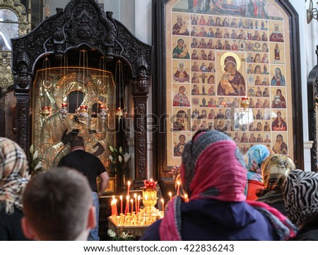 MOSCOW - APRIL 30, 2016: Unidentified people pray at the celebration of Orthodox Easter by the church of the Resurrection of Christ in Sokolniki. - stock photo