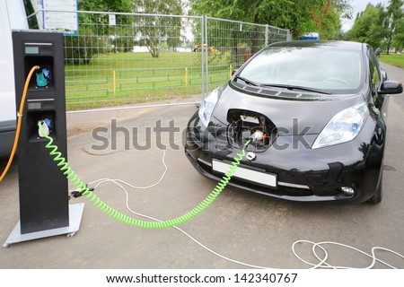 MOSCOW - AUGUST 18: Modern electric car recharged at electrical charging at festival Ekofest 2012 on banks of Stroginsky gulf, on August 18, 2012 in Moscow, Russia. - stock photo