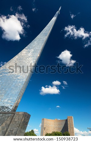 MOSCOW - AUGUST 17: Monument to the Conquerors of Space and Cosmos Hotel on august 17, 2013 in Moscow. This famous monument was erected in 1964 in memory of the Soviet space explorers. - stock photo