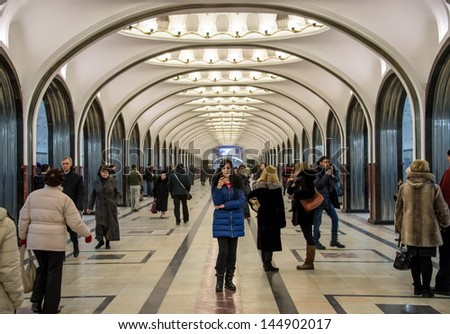 MOSCOW - CIRCA MARCH 2013: People in the famous Mayakovskaya Metro Station circa March 2013. With a population of more than 11 million people is one the largest cities in the world. - stock photo