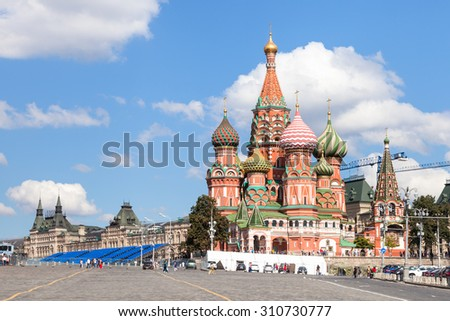 Moscow cityscape - Pokrovsky Cathedral and Vasilevsky Descent of Red Square of Moscow Kremlin in sunny summer day - stock photo