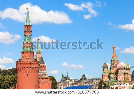 Moscow cityscape - Towers of Moscow Kremlin, Saint Basil Cathedral on Red Square of Moscow Kremlin in sunny summer day - stock photo