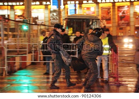 MOSCOW - DEC 4 - Parliamentary elections in Russia: an activist is arrested by the police during an anti-government and anti-elections demonstration on december 4, 2011 in Moscow - stock photo