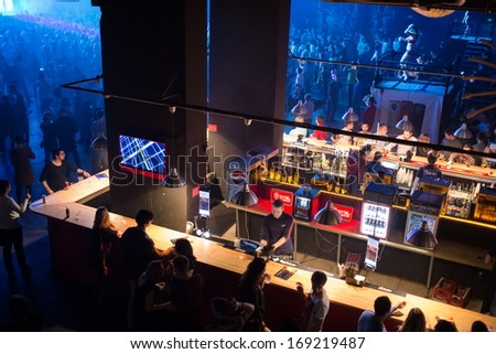 MOSCOW - DEC 8: People buy drinks in the bar near the dancefloor with showgirls on GLOBALCLUBBING Mind Games in Stadium Live on December 8, 2013 in Moscow, Russia. - stock photo