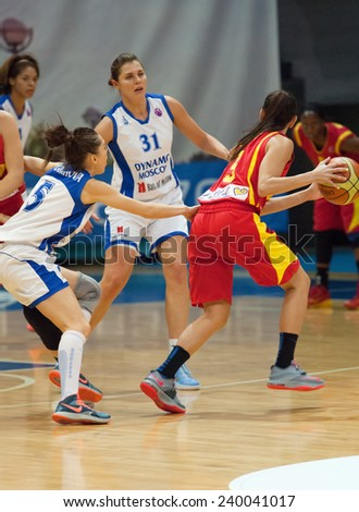 MOSCOW - DECEMBER 4, 2014: A. Petrakova (31) and k. Selwyn (5) in action during the International Europe bascketball league match Dynamo Moscow vs Maccabi Ashdod in Moscow, Russia. Dynamo loss 59:67 - stock photo