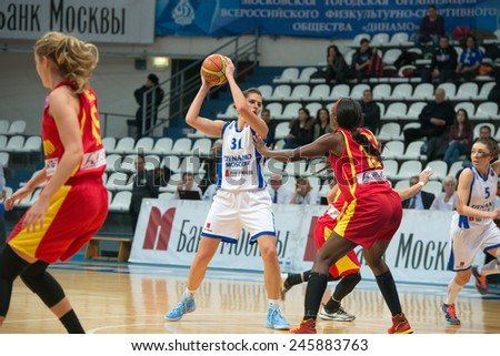 MOSCOW - DECEMBER 4, 2014: A. Petrakova (31) on the International Europe bascketball league match Dynamo Moscow vs Maccabi Ashdod Israel in sport palace Krilatskoe, Moscow, Russia. Dynamo loss 59:67 - stock photo