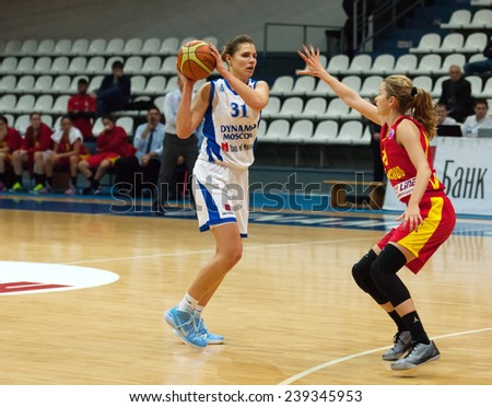 MOSCOW - DECEMBER 4, 2014: A. Petrakova (31) versus K. Antic (15) during the International Europe bascketball league match Dynamo Moscow vs Maccabi Ashdod Israel in Moscow, Russia. Dynamo loss 59:67 - stock photo