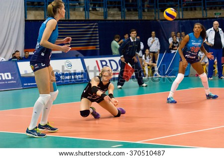 MOSCOW - DECEMBER 2: Anna Malova (3) take a ball on a game Dynamo MSK vs Dynamo KZN on Russian National wemen Volleyball tournament on December 2, in Moscow, Russia, 2015 - stock photo