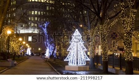 MOSCOW - DECEMBER 31, 2013: Christmas tree and illumination on Neglinnaya street. - stock photo