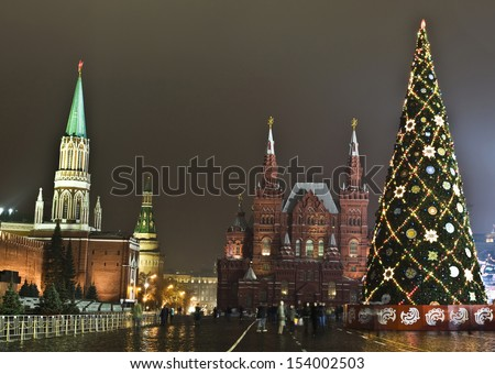 MOSCOW - DECEMBER 14: Christmas tree on Red square, Historical museum and Kremlin, December 14, 2011, in town Moscow, Russia. - stock photo