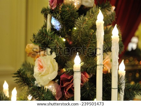MOSCOW - DECEMBER 21: Close-up of Christmas tree, electric candles and ornaments inside GUM store on December 21, 2014 in Moscow. - stock photo