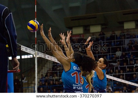 MOSCOW - DECEMBER 2: F. G. Rodrigez (16) and N. Obmochaeva (8) in action on a game Dynamo MSK vs Dynamo KZN on Russian National wemen Volleyball tournament on December 2, in Moscow, Russia, 2015 - stock photo
