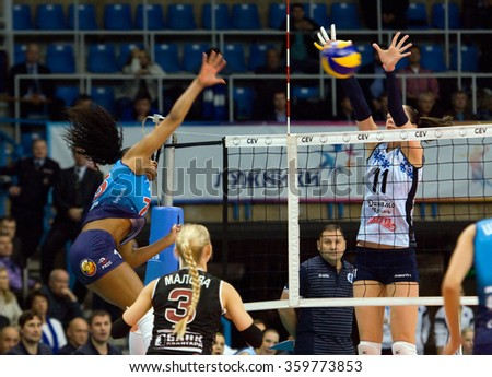 MOSCOW - DECEMBER 2: Fernanda Garai Rodrigez (16) attack on a game Dynamo MSK vs Dynamo KZN on Russian National women Volleyball tournament on December 2, in Moscow, Russia, 2015 - stock photo