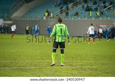 MOSCOW - DECEMBER 7: Goalkeeper Roman Gerus on the football match on Russian Premier League Dynamo (Moscow) vs Amkar (Perm)  on December 7, 2014, in Moscow, Russia. Dynamo won 5: 1 - stock photo