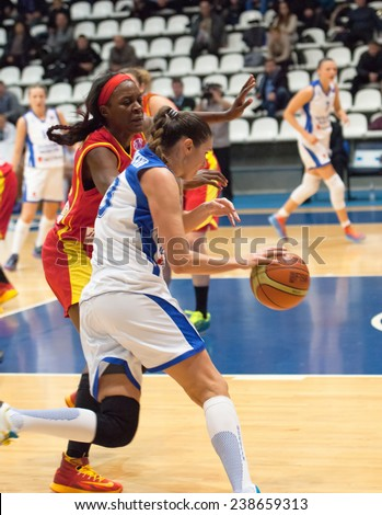 MOSCOW - DECEMBER 4, 2014: I. Sokolovskaya (13) dribble during the International Europe bascketball league match Dynamo Moscow vs Maccabi Ashdod Israel in Moscow, Russia. Dynamo loss 59:67 - stock photo