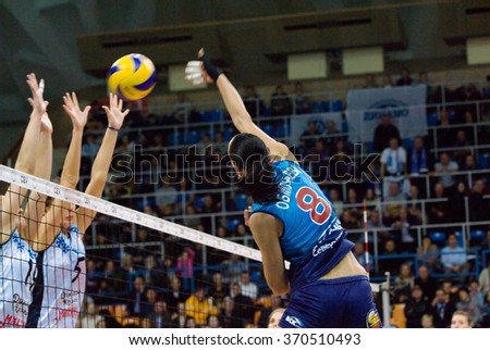 MOSCOW - DECEMBER 2: N. Obmochaeva (8) attack on a game Dynamo MSK vs Dynamo KZN on Russian National wemen Volleyball tournament on December 2, in Moscow, Russia, 2015 - stock photo