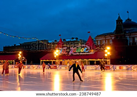 MOSCOW - DECEMBER 15, 2014: People at GUM Skating rink on Red Square is open from December 1 to March 10 and contains 450 people in Moscow, Russia.  - stock photo