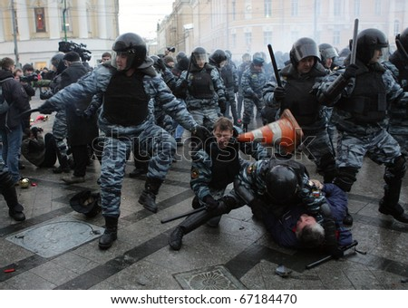 MOSCOW - DECEMBER 11: Police scuffle with protesters during a rally in central Moscow December 11, 2010. A few thousand people gathered to demand justice for Spartak Moscow fan Yegor Sviridov. - stock photo