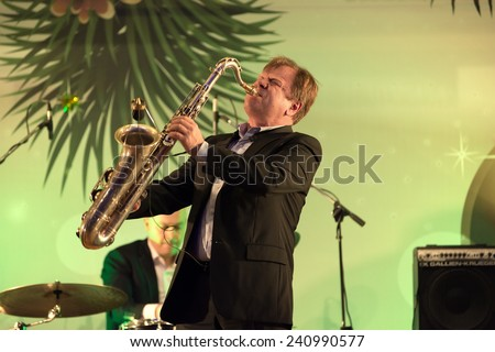 MOSCOW - DECEMBER 26: Russian musician Igor Butman  on a New Year concert on December 26, 2013 in Moscow, Russia - stock photo