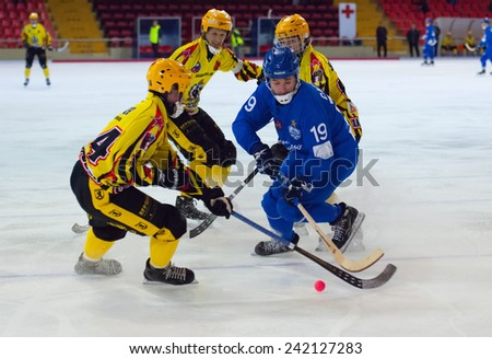 MOSCOW - DECEMBER 12, 2014: Saveliev Dmitry in action during the Russian  bandy league game Dynamo Moscow vs SKA Neftyanik in sport palace Krilatskoe, Moscow, Russia. Dynamo won 9:1 - stock photo