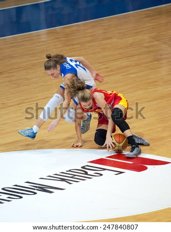MOSCOW - DECEMBER 4, 2014: T. Grigorieva (23) fight on the International Europe bascketball league match Dynamo Moscow vs Maccabi Ashdod in sport palace Krilatskoe, Moscow, Russia. Dynamo loss 59:67 - stock photo
