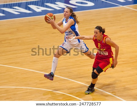 MOSCOW - DECEMBER 4, 2014: T. Grigorieva (32) in action during the International Europe bascketball league match Dynamo Moscow vs Maccabi Ashdod Israel in sport palace Krilatskoe, Moscow, Russia - stock photo