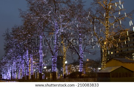 MOSCOW - DECEMBER 30, 2013: trees illuminated for Christmas and New Year holidays on Pushkinskaya square. - stock photo