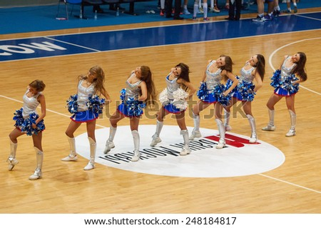 MOSCOW - DECEMBER 4, 2014: Unidentified cheerleaders of Dynamo team dance on the International Europe bascketball league game Dynamo Moscow vs Maccabi Ashdod in sport palace Krilatskoe, Moscow, Russia - stock photo