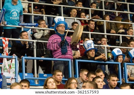 MOSCOW - DECEMBER 2: Unidentified fan of Dynamo team with drum on a game Dynamo MSK vs Dynamo KZN on Russian National women Volleyball tournament on December 2, in Moscow, Russia, 2015 - stock photo
