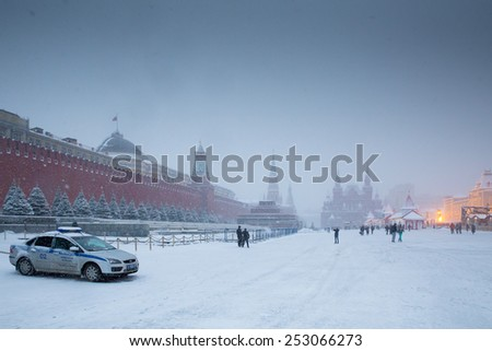 MOSCOW - FEBRUARY 03: Red Square, Kremlin, Lenin mausoleum and police car in Russian winter time, February 03, 2015, Moscow, Russia - stock photo