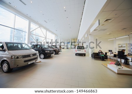 MOSCOW - JAN 11: The Official Dealer Volkswagen - Center Varshavka, hall with a range of cars on January 11, 2013, Moscow, Russia. Volkswagen dealership offers a full range of cars Volkswagen - stock photo