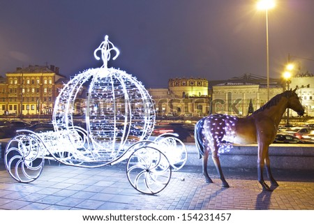 MOSCOW - JANUARY 06: christmas decoration on street - electric carriage with sculpture of horse, on Komsomolskaya square near Leningradskiy railway station, January 06, 2012, in Moscow. - stock photo