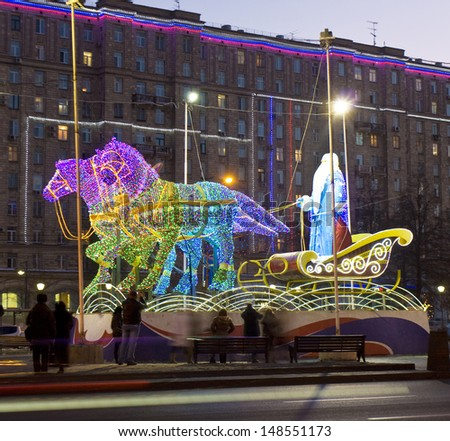 MOSCOW - JANUARY 02: electric sculptures of Santa Claus on carriage with horses, decoration to Christmas and New year holidays on the street, January 02, 2013, in town Moscow, Russia. - stock photo