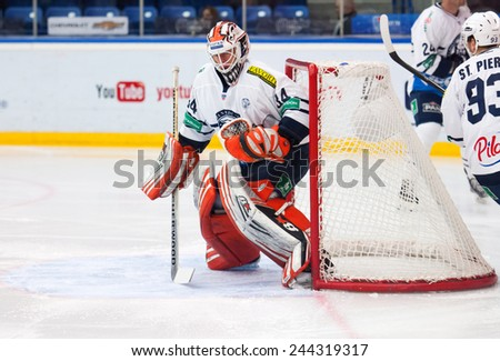 MOSCOW - JANUARY 10: Goalkeeper Mark Owuya in action on hockey game Vityaz vs Medvezchak on Russian KHL premier hockey league Championship on January 10, 2015, in Moscow, Russia. Medvezcak won 3:2 - stock photo